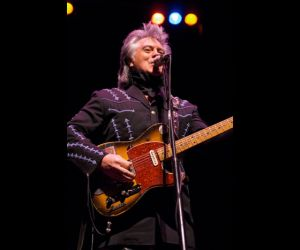 Marty Stuart with Clarence White's famous B Bender guitar.
